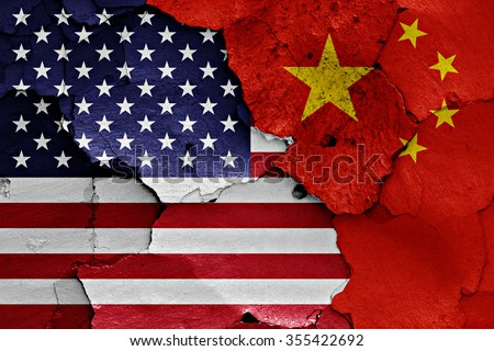 flags of USA and China painted on cracked wall