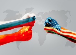 Flags of usa or United States of America VS China and  Russia on hands punch to each others on world map background, Conflict world concept