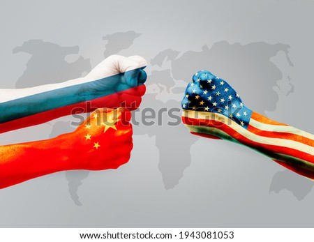 Flags of usa or United States of America VS China and  Russia on hands punch to each others on world map background, Conflict world concept ストックフォト ©