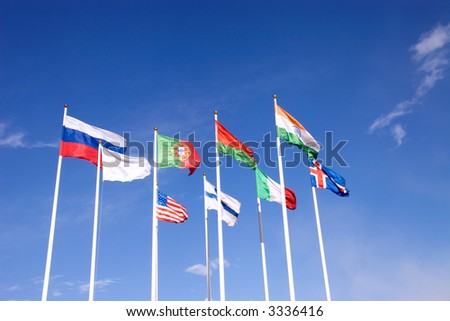 Flags on blue sky background.