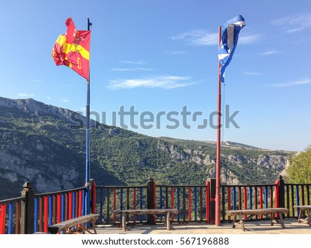 flags over wooden fence against ...