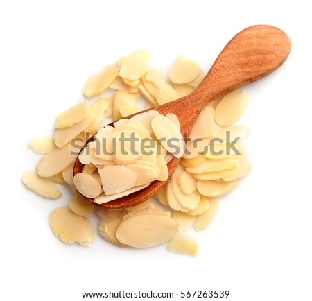 Flaked almonds close up on white backgrounds. #567263539