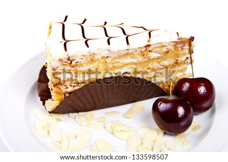 Flaky cake with cherries and almond on white background