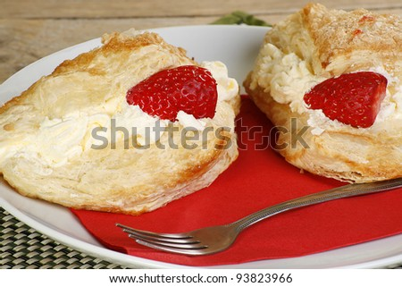 flaky pastry cakes filled with whipped cream apple and strawberries