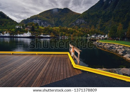 Flam, Norway / Norway - September 2017:  Autumn day on the shore of the Flam fjord. #1371378809