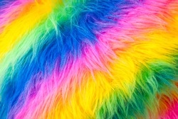 Flamboyant rainbow colored background of fuzzy fake fur