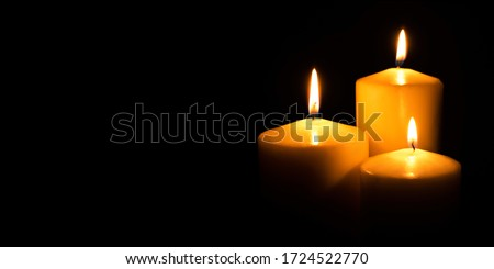 Photo of  Flame candles isolated on black background. Close up.