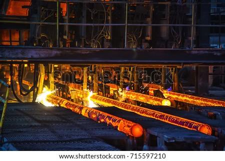 Flame cutting hot ingot