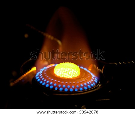 Flame in gas stove on dark background