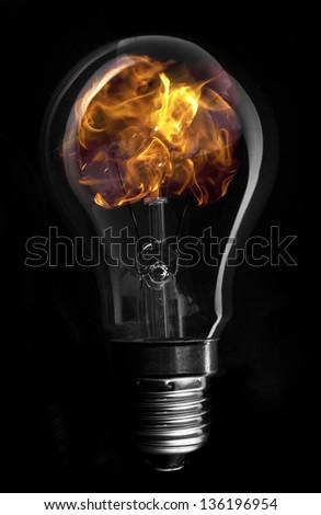 Flame inside light bulb on black background #136196954