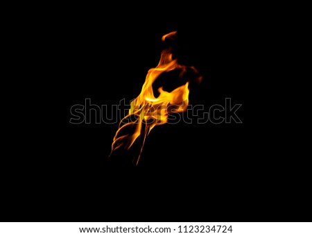 flame of a torch in the dark on a black background, only the fire is visible