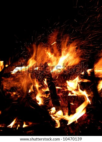 Flame of fire in a night-time - stock photo