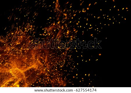 Flame of fire with sparks on a black background #627554174