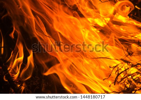 Flame pattern on a black background for graphic design or wallpaper #1448180717
