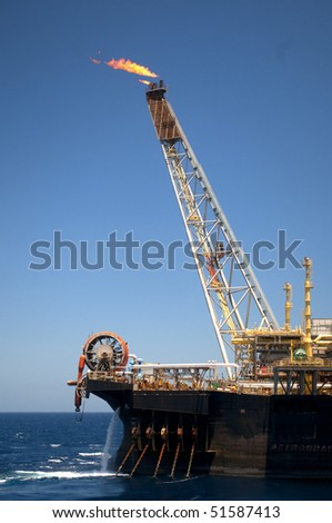 flame tower of an oil rig in offshore area in coast of brazil