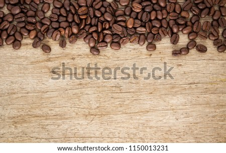 Flame with Coffee beans on old wood background