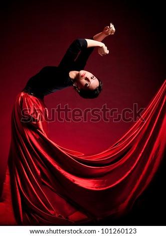 Flamenco Carmen beautiful woman in dress on dark background - stock photo