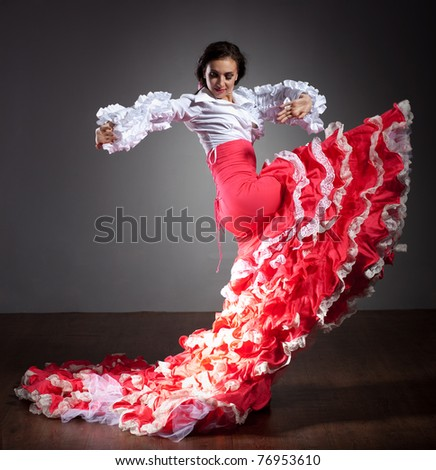 Flamenco dancer in beautiful dress on dark background