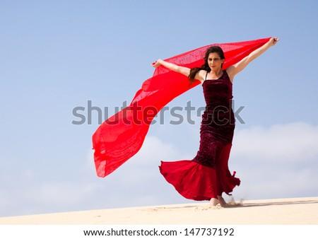 Flamenco dancer in the long dress in the dunes - Shutterstock ID 147737192