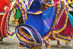 Flamenco dancer is hidden by her brightly colored twirling skirt while she dances. A dancers in a colorful dress. Colorful skirts of Spanish Flamenco dancers
