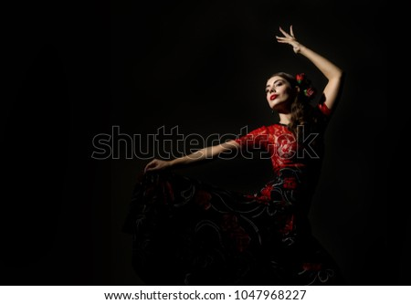 Photo of  flamenco dancer on a dark background. free space for your text