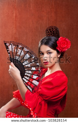 Flamenco dancer Spain woman gypsy with red rose spanish hand fan and peineta comb