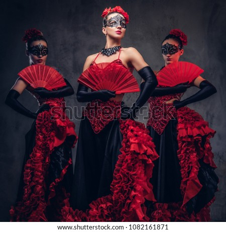 Flamenco spanish seductive dancers wearing traditional costume.