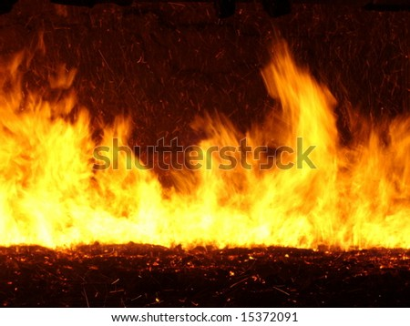Flames and fire on a grate in a power plant - stock photo