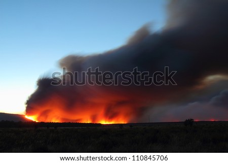 Flames and smoke column Castrocontrigo wildfire, Leon, started August 19, 2012