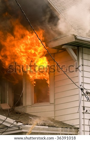 Flames and smoke of a bad house fire