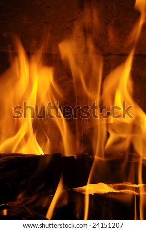 Flames burning high in a fireplace