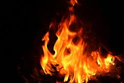 Flames from a bonfire of hot energy that ignited fuel On a black background