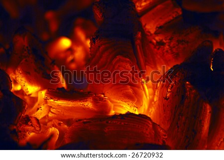 flames from a fire burning inside an oven