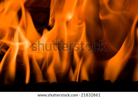Flames in a fireplace in a house at cold weather