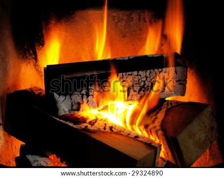 flames of burning firewood in a fireplace
