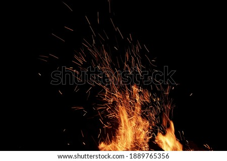 Flames Of Fire And Sparks Isolated On Black Background. Abstract Flaming Background. Magic Fiery Wallpaper. Flying Sparks Background,  Closeup View. Bonfire Flaming In The Night. Energy Concept.