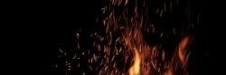 Flames Of Fire And Sparks Particles Isolated On Black Background. Abstract Flaming Background. Magic Fiery Wallpaper. Flying Sparks Background,  Closeup View. Bonfire Flaming In The Night.