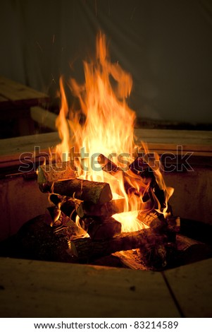 Flaming Bonfire in front dark environment