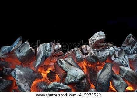 Flaming Charcoal In BBQ Grill Pit Isolated On Black Background #415975522