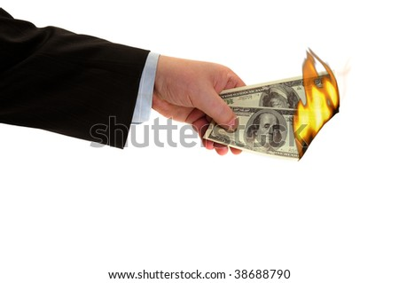 Flaming money in hand, isolated on white background
