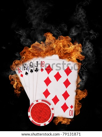 Flaming poker cards triumph, isolated on black background