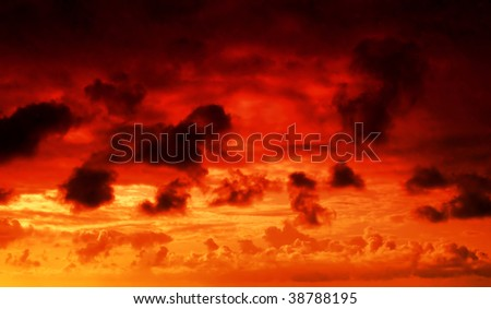 flaming red fire in the sky cloudscape background
