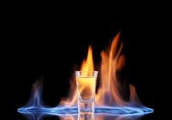 Flaming vodca on black background