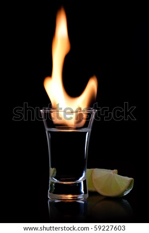 Flaming vodka, and lime over black