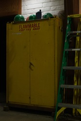 flammable keep fire away storage cabinet of combustable materials at fire station with ladder wapato washington yakima county