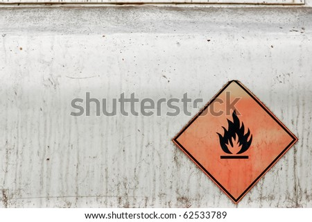Flammable material weathered warning sign background. Fuel tank.