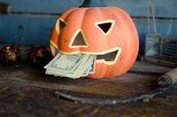 Flanders / Belgium - 07/23/2019 : Scary pumpkin Jack decoration or halloween business commerce in the end of october.