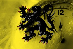 Flanders, Flemish flag with clock close to midnight in the background. Happy New Year concept