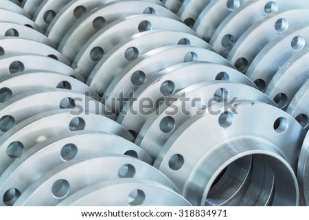 Flanges stacked in warehouse, selective focused #318834971