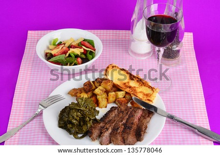 Flank steak Braised in Merlot Wine Sauce, turnip greens simmered in basalmic vinegar, roast potatoes and green salad.  Served with Merlot Wine in long-stem glass.